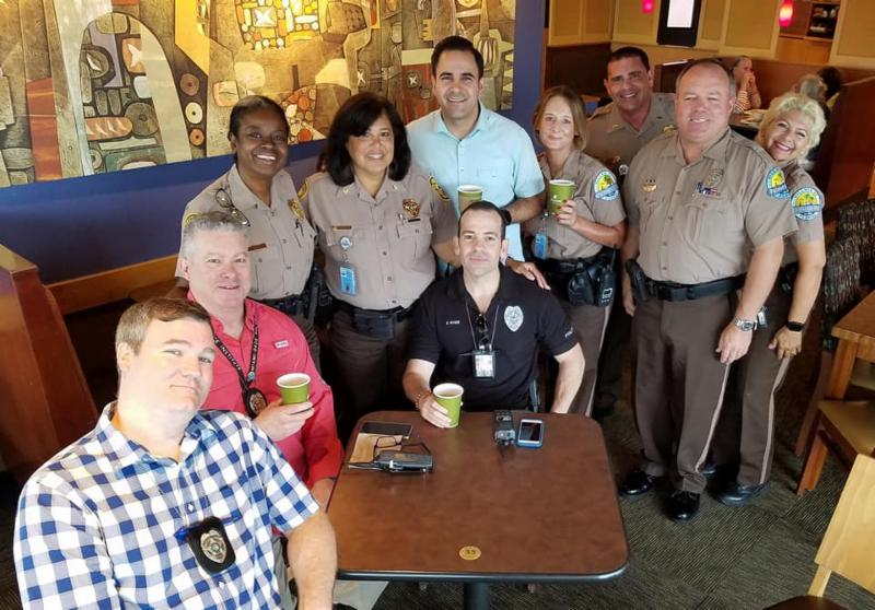 """Photo of members of Palmetto Bay Policing Unit enjoying the """"Coffee with a Cop"""" event at Panera Bread at 136th street and u-s one on April 10, 2019"""