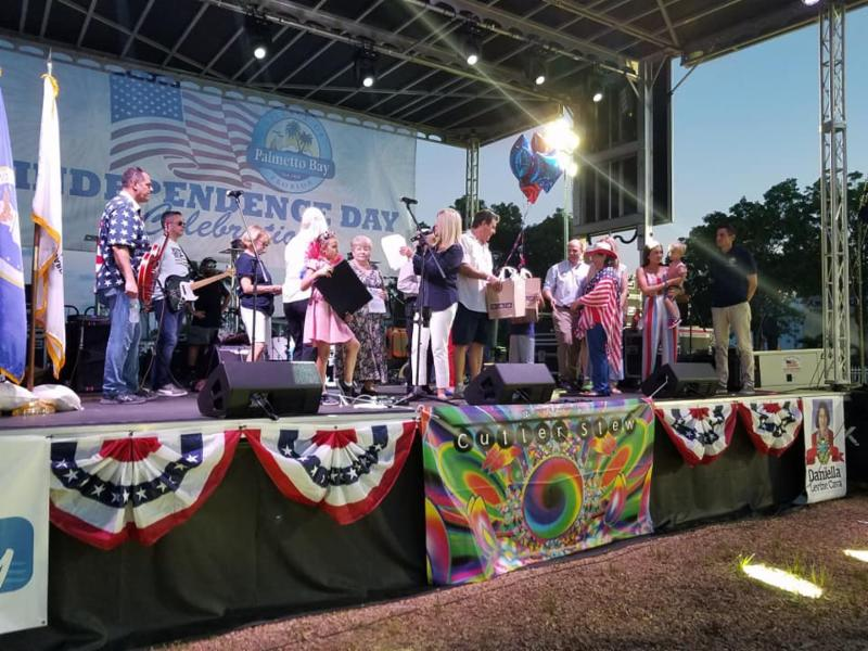 People onstage at the Independence Day Extravaganza