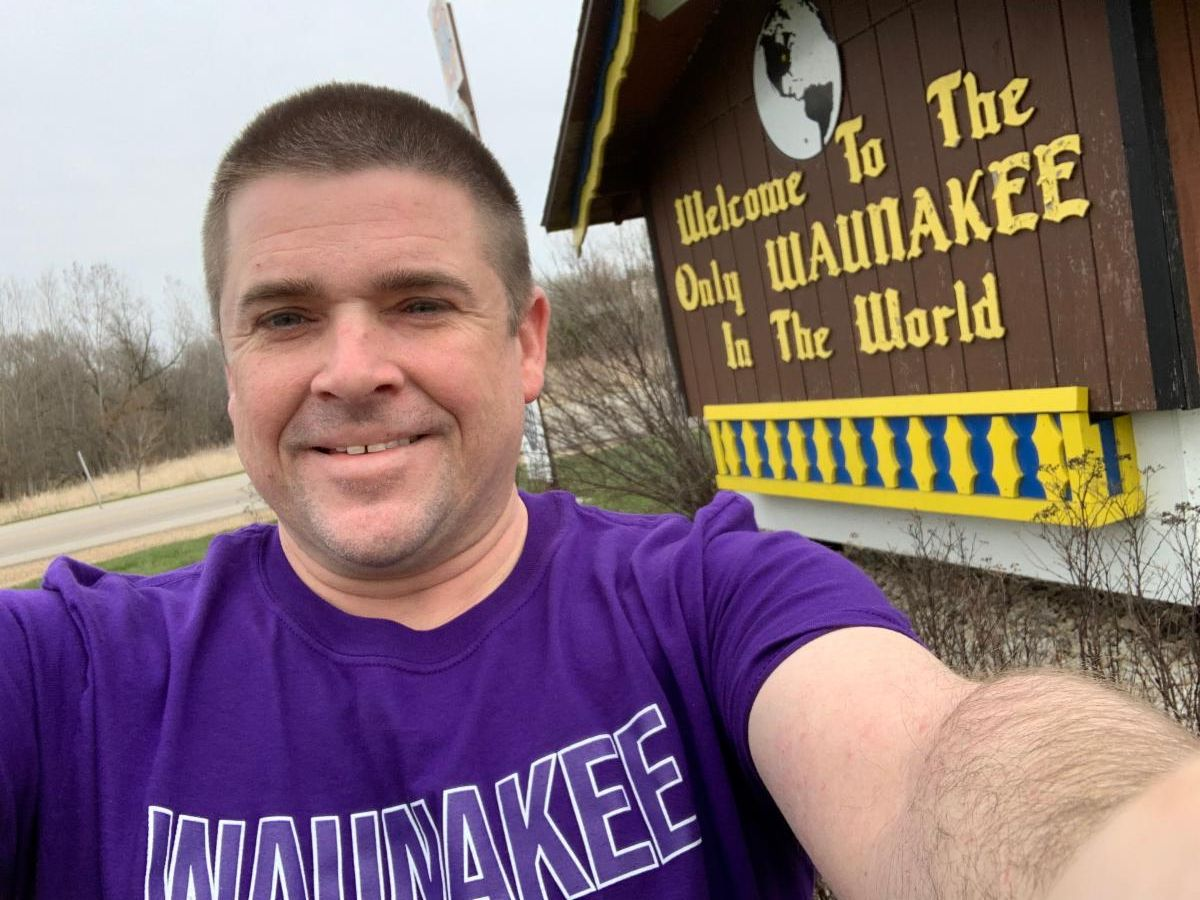 Todd in front of the ONLY Waunakee in the world sign