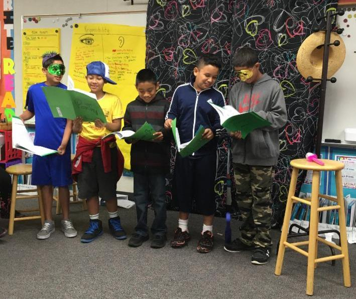 5th grade students reading poetry