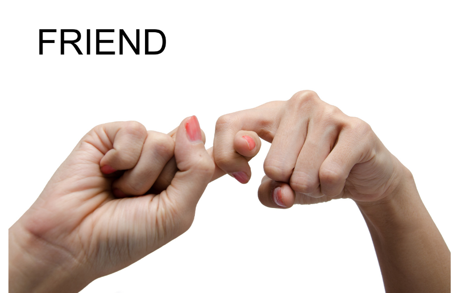 caucasian woman's hands making the sign for 'friend' in American Sign Language