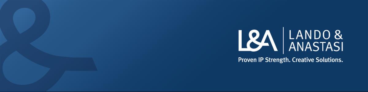 Lando & Anastasi blue header image with ampersand