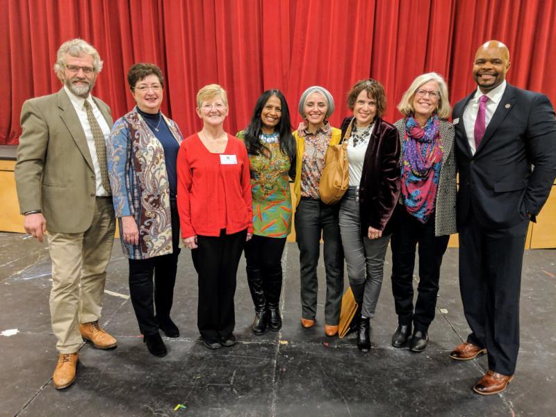 L-R Gareth Young, Dorie Griggs, Kathy Hoffman, Sucheta Kamath, Noor Abaddy, Corey-Jan Albert, Valerie Morvan, Mr. Rick Holifield (The Walker School)