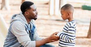 African-American father talking to his child about difficult news