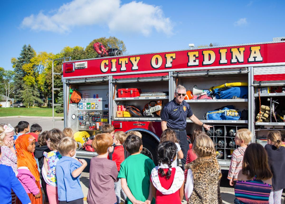 Edina firefighter visits with EPS students