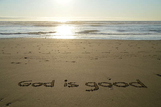 God is good written in the sand.