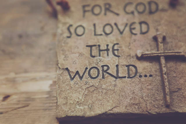 For God so loved the world carved in stone