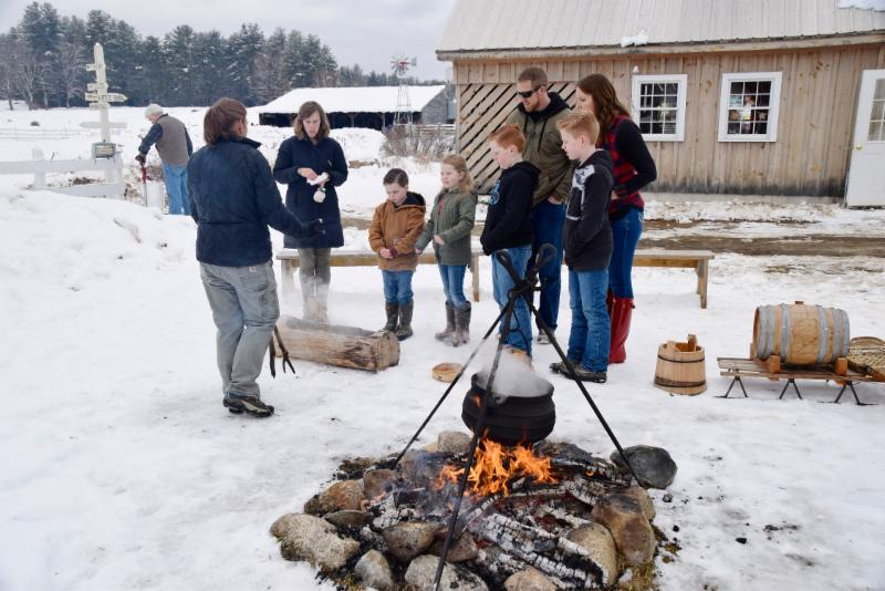 Family learning about  Abenaki Indian boiling practices