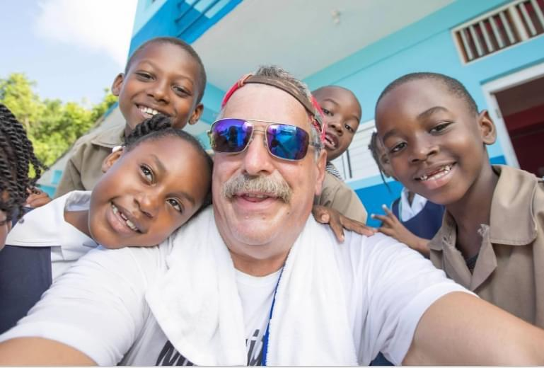 Chris Panetta with children at Freehill Primary School
