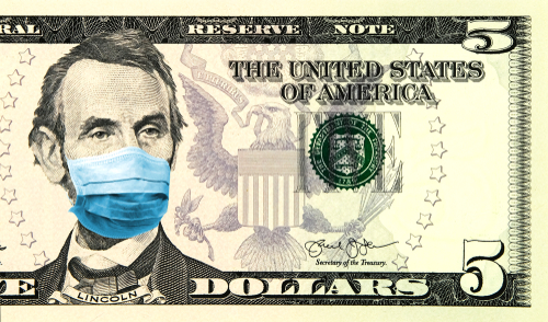 Coronavirus in United States. Quarantine and global recession. 5 American dollar banknote with a face mask against infection. Global economy hit by corona virus outbreak and pandemic. Montage. Concept