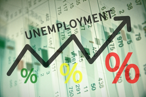 Word unemployment on up trend arrow_ with financial data visible on the background.