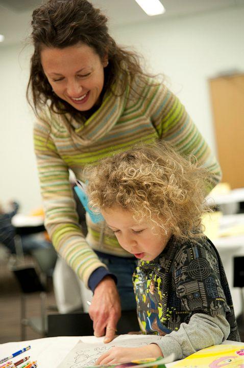 Woman and child making art at NMAJH