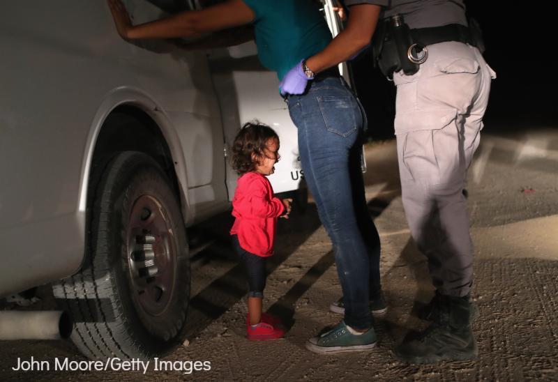 Photo credit: John Moore/Getty Images. Border Patrol Agents Detain Migrants Near US-Mexico Border