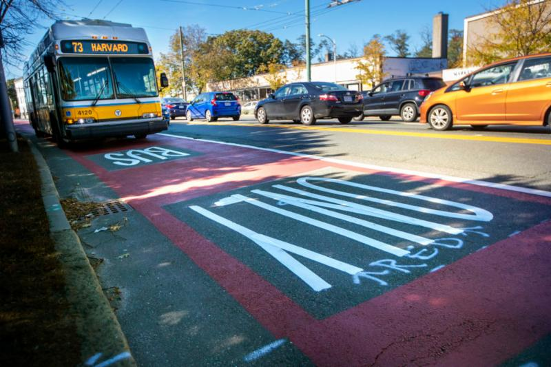 WBUR An MBTA 73 bus bound for Harvard Square travels through the red painted lane restricted for buses and bicycles on Mt. Auburn Street at the Cambridge Watertown line. Jesse Costa - WBUR