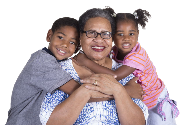 African American Grandmother smiling as her grandson and granddaughter hug her.