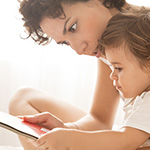 Mother reading to her child.