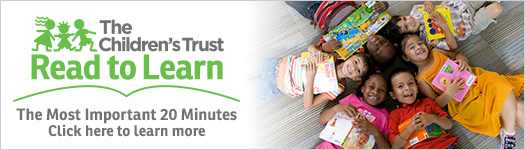 Ad for Read to Learn initiative. Children laying on the carpet looking up holding books smiling. The most  important 20 minutes. Click here to learn more.