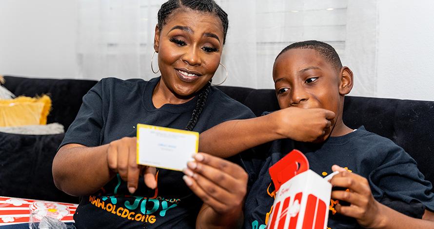 Magdala Chery and son Jonathan-David Chery enjoy a Box Joy package.