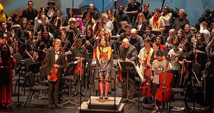 Wonderwoman aka Maestra Huifang Chen conducts the Greater Miami Youth Symphony.