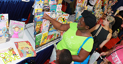 Mother and son shop discounted books.