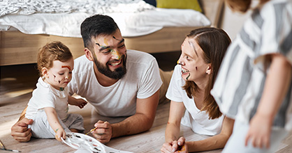 A family enjoys time playing with each other at home.