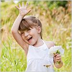 Smiling little girl waving good-bye.