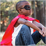 Boy with super hero mask and cape