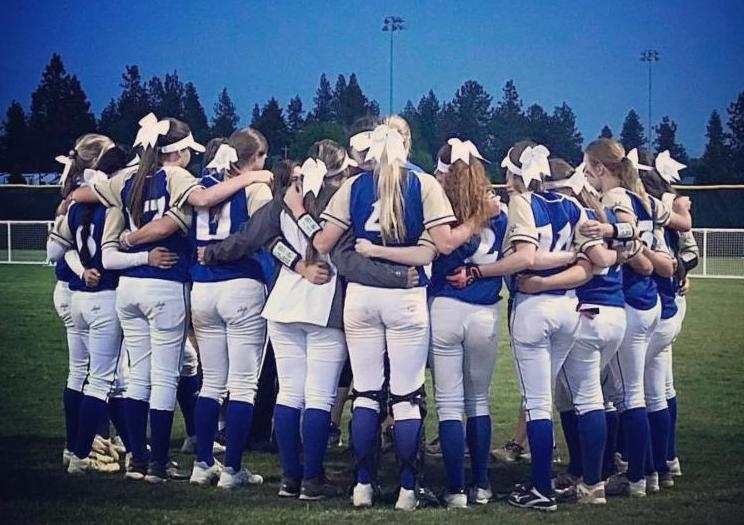 Members of the THS fast pitch softball team huddle together during the state tournament in Spokane