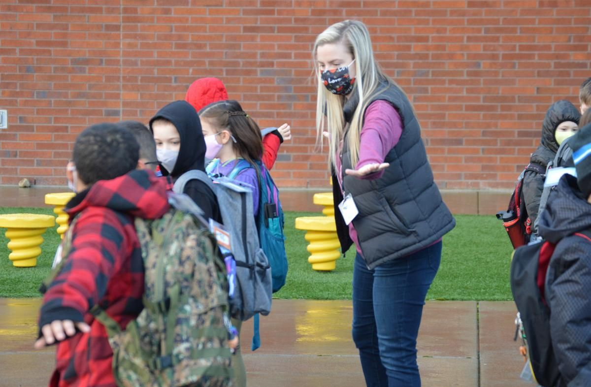 Teacher Alyse Lynn shows students at Lake Wilderness how to stay six feet apart