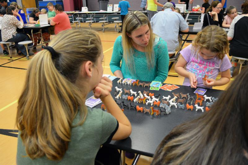 A student and parent play a pattern game during family night