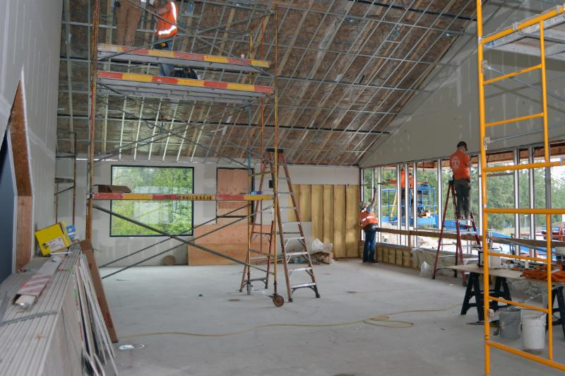 Crews from FORMA work on the library at the new Lake Wilderness Elementary