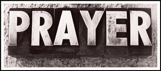 The word  PRAYER  written in old vintage letterpress type.