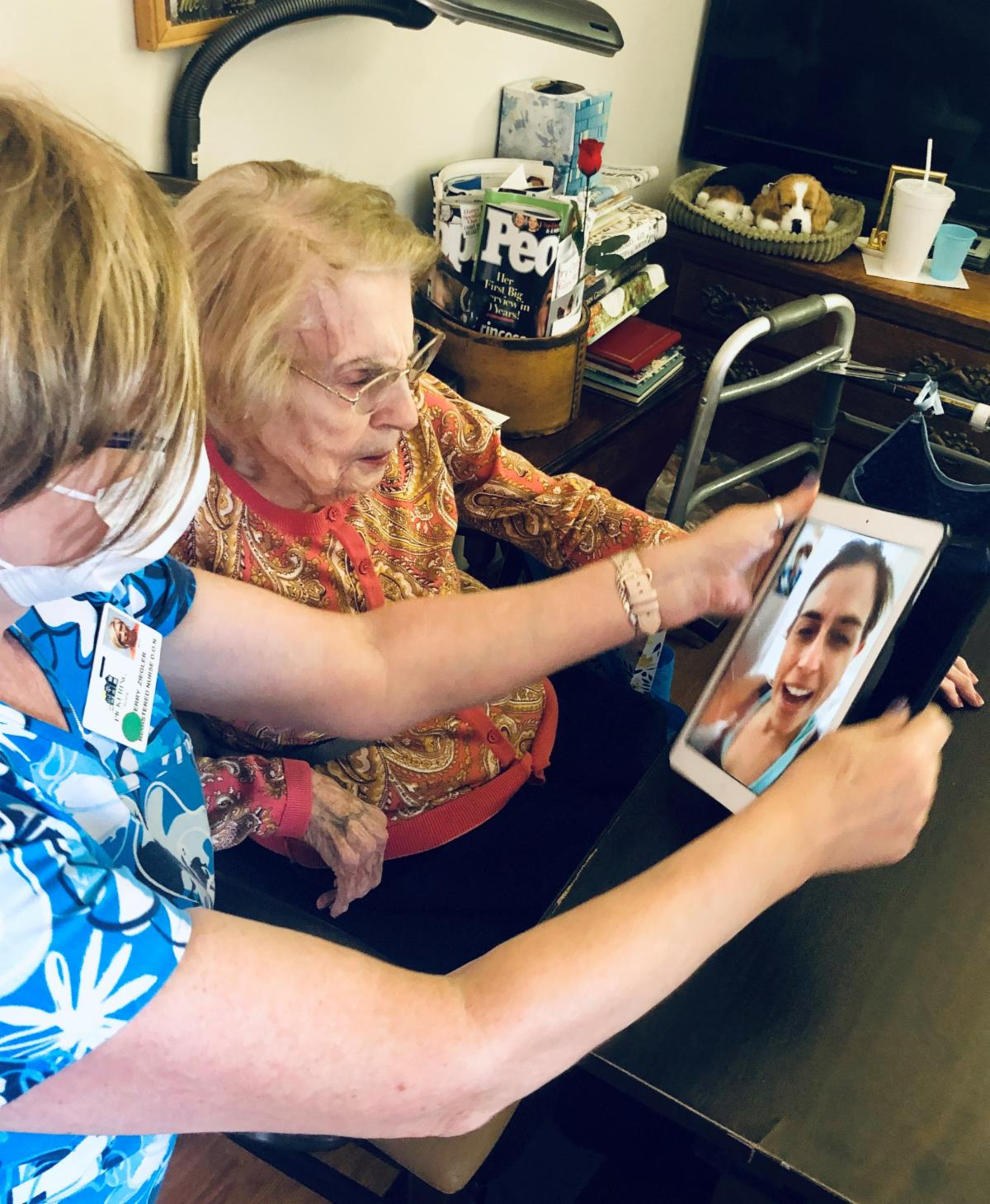 Director of Nursing Terry Ziegler helping resident Irene Bittner connected with her family through Pickering's iPad
