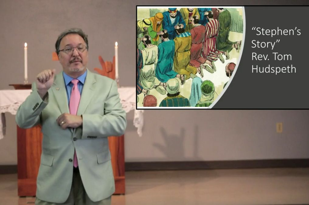 Tom Hudspeth preaching with background picture of Stephen