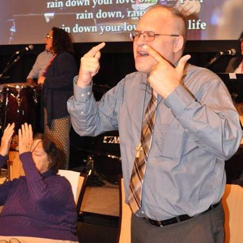 Leo doing sign language interpreting