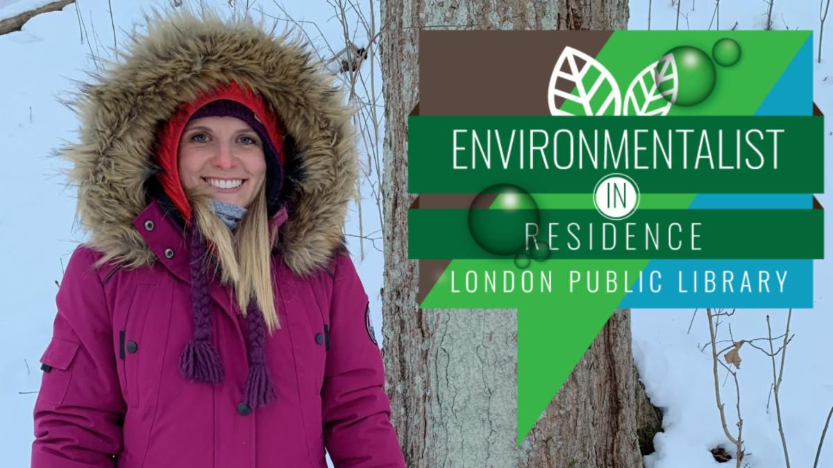 Photo of Dr. Andrea Boyer in a winter coat, standing by a tree in Meadowlily Woods with snow on the ground. Environmentalist in Residence London Public Library.