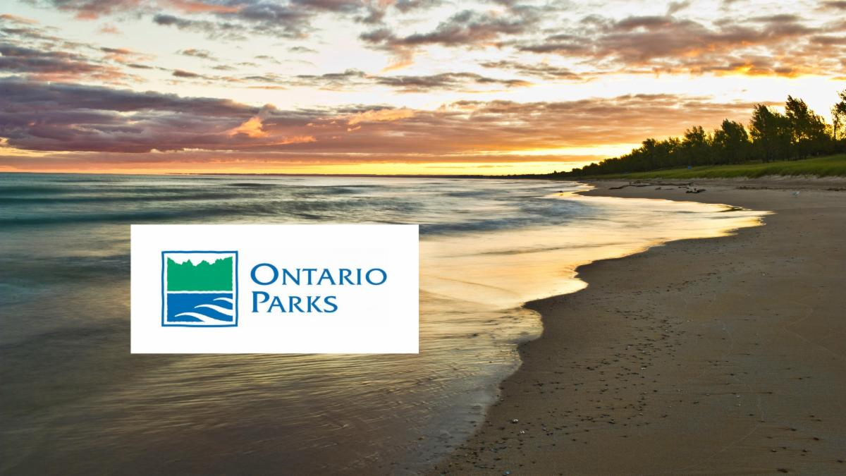 Photo of Pinery Provincial Park beach at sunset with the Ontario Parks logo on top.