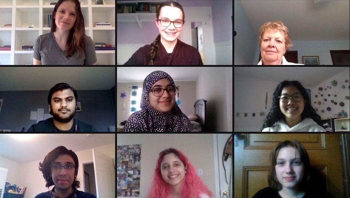 Photo of a computer screen showing the Zoom screens of 9 Library volunteers, all smiling.