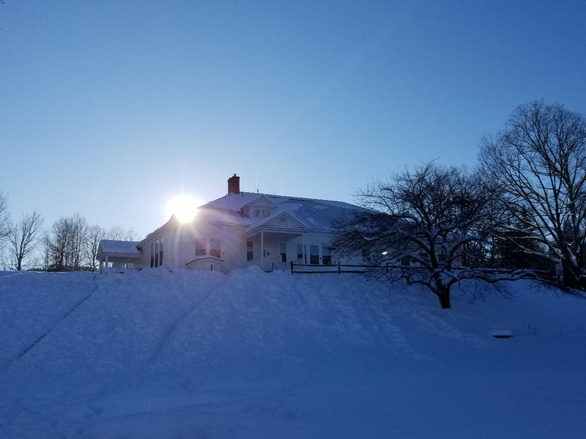 Setting sun behind the Newton School in winter