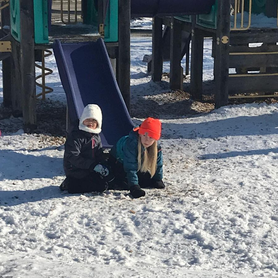 Children playing in the new snow at recess
