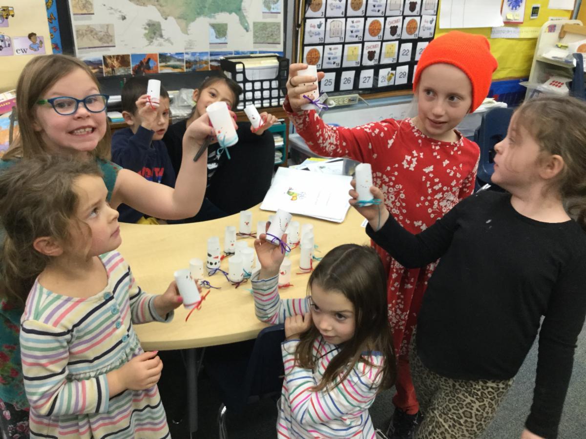 The K-2 cluster makes snowman votives for the Seniors