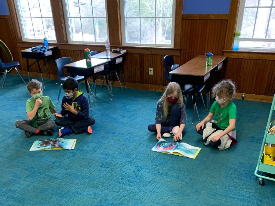Second graders work in pairs on math problems in the classroom