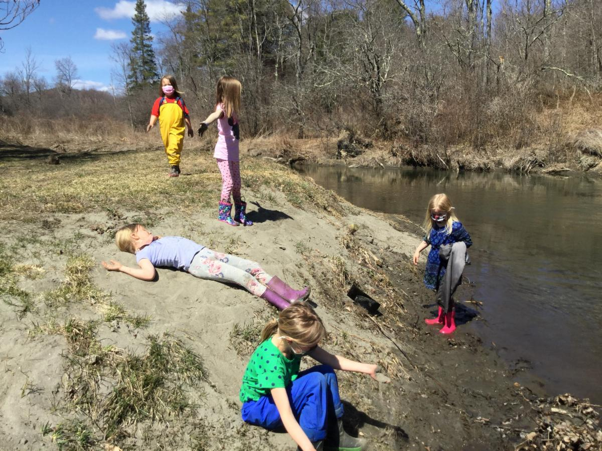Kindergarten relaxes and explores by the water