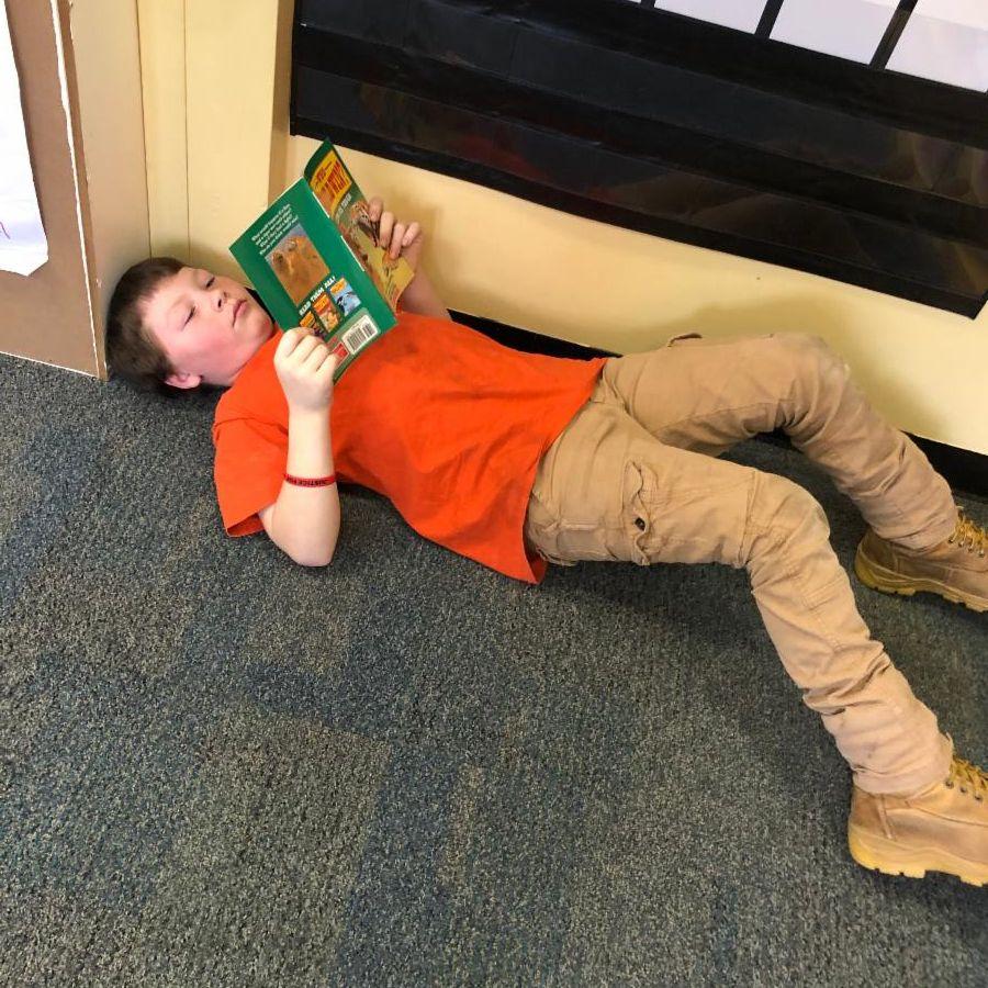 Third grade student reading