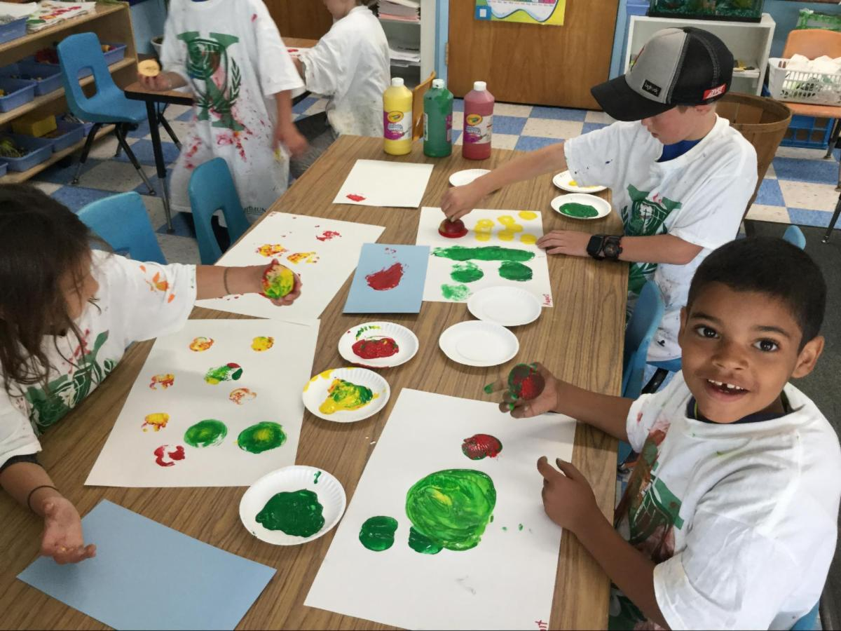 Students making apple art