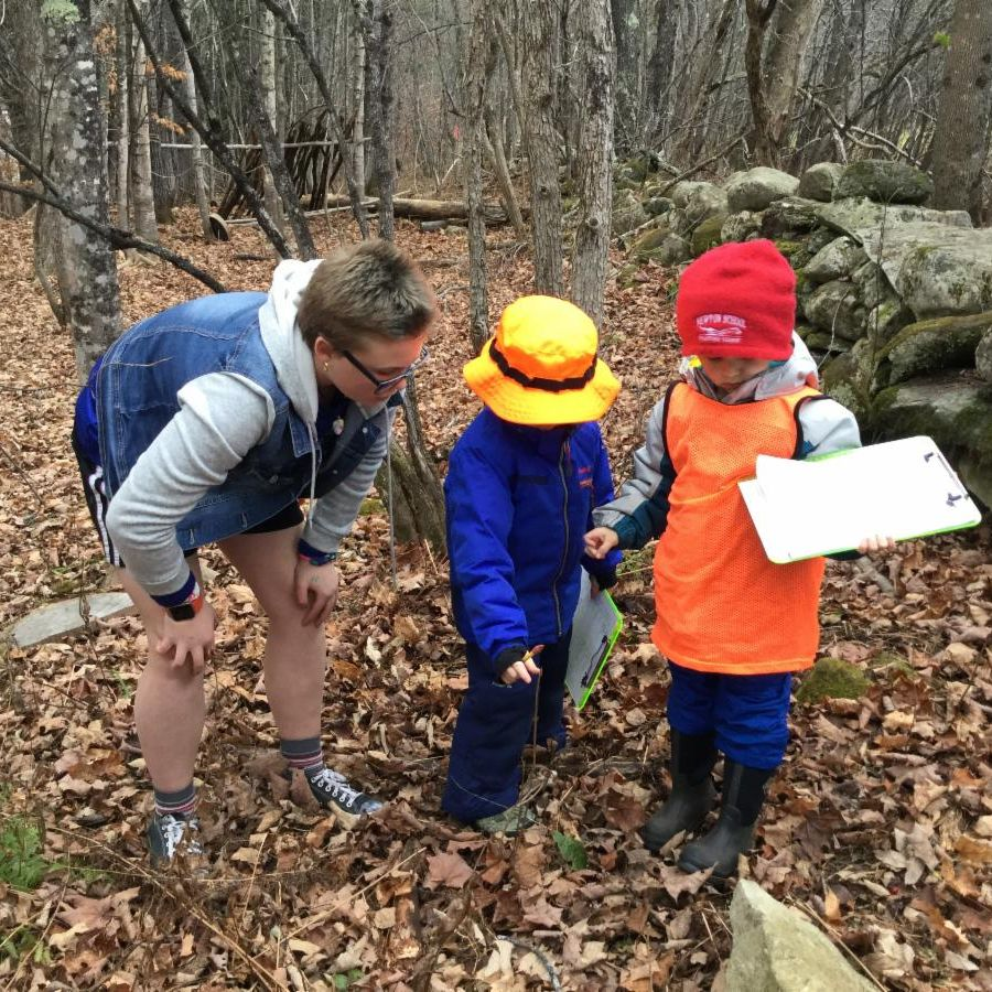 Heidi helps two kindergartners with their Senses Search in the Outdoor Classroom.