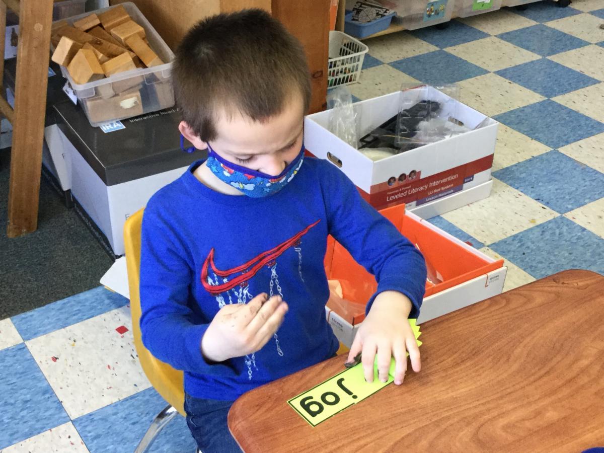 Kindergarten student takes part in phonics activities