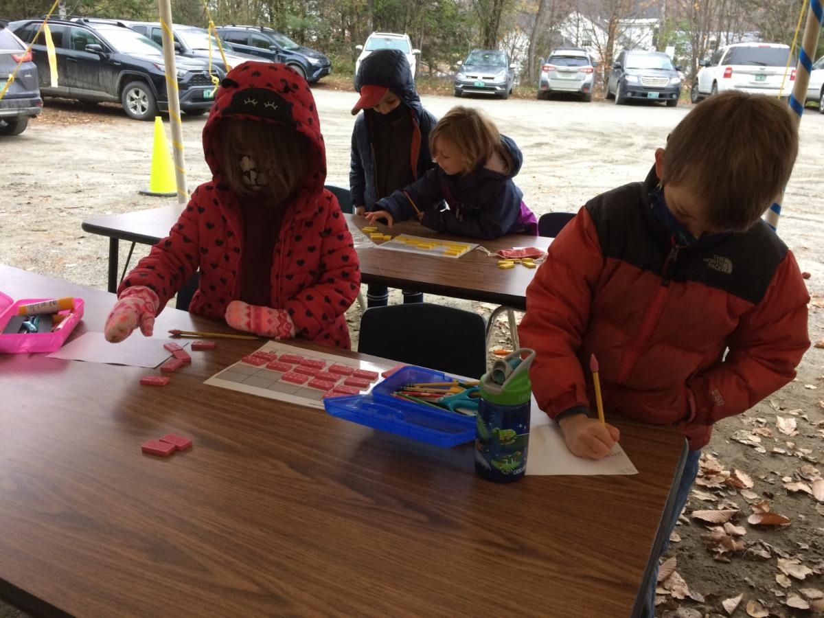 First graders have math class in their outdoor classroom.