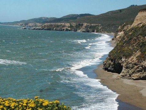 The coastline with ocean meeting cliffs
