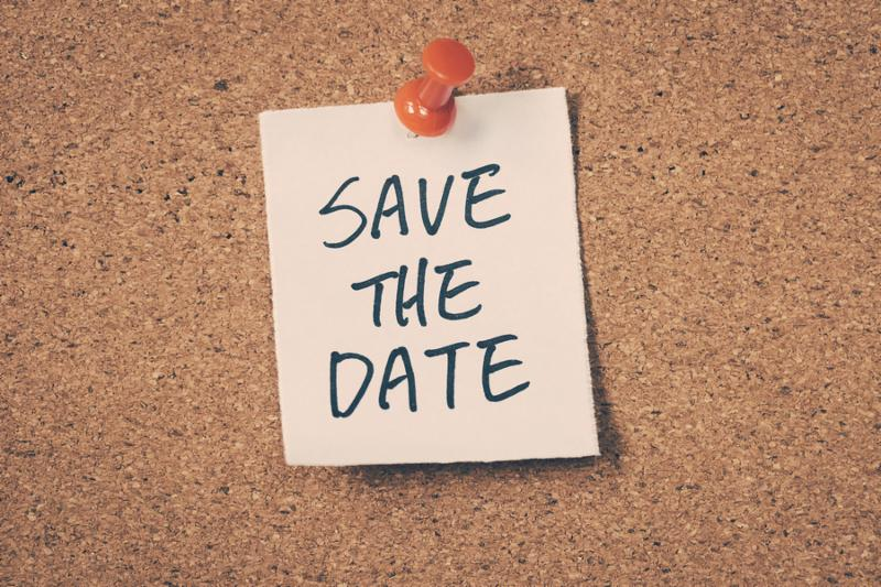 Save the date note pinned on the bulletin board